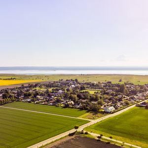 Säljarens bild över Gessie villastad och Öresund